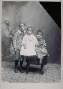 Studio portrait of three unidentified African American children