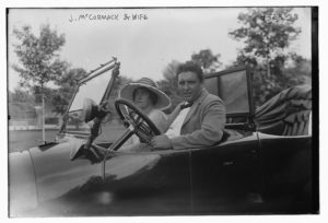 Irish American tenor singer John McCormack seated in an automobile with his wife