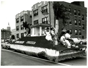 Puerto Rican parade float with replica house, Hartford, 1967